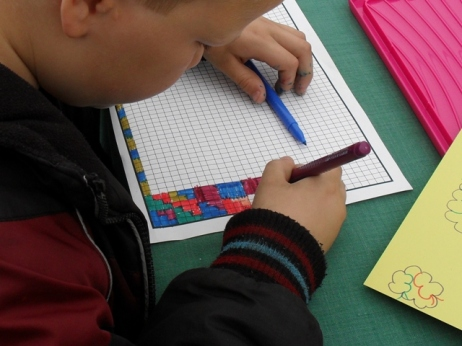 A Carpet Club member busy at work designing new patterns